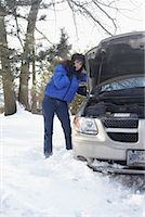 stalled car - Woman on cellphone in snow    Stock Photo - Premium Rights-Managednull, Code: 700-01235321