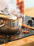 Pot of Sauce Boiling Over on Stove    Stock Photo - Premium Rights-Managed, Artist: Mark Burstyn, Code: 700-01235882