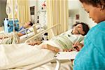 Nurse Checking on Patients    Stock Photo - Premium Royalty-Free, Artist: Masterfile, Code: 600-01236231