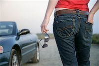 Woman Looking at Convertible    Stock Photo - Premium Rights-Managednull, Code: 700-01236396