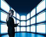 Businesswoman in Front of Video Wall    Stock Photo - Premium Rights-Managed, Artist: Ken Davies, Code: 700-01236468