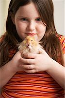 Portrait of Girl Holding Hamster    Stock Photo - Premium Rights-Managednull, Code: 700-01236575