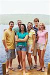 Family Standing on Dock, Belgrade Lakes, Maine, USA    Stock Photo - Premium Royalty-Free, Artist: Peter Barrett, Code: 600-01236640