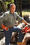 Man Cutting Wood With Chainsaw    Stock Photo - Premium Rights-Managed, Artist: Peter Barrett, Code: 700-01236659