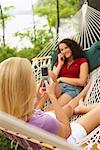 Teenagers Using Cellular Phones, Maine, USA    Stock Photo - Premium Rights-Managed, Artist: Peter Barrett, Code: 700-01236668
