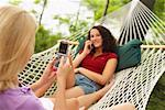 Teenagers Using Cellular Phones, Maine, USA    Stock Photo - Premium Rights-Managed, Artist: Peter Barrett, Code: 700-01236669