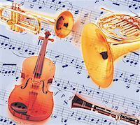 Musical Instruments Superimposed on Sheet music Stock Photo - Premium Royalty-Freenull, Code: 618-01242133