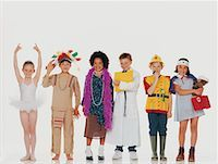 Children wearing costumes, standing in row Stock Photo - Premium Royalty-Freenull, Code: 618-01246868