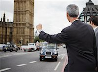 Businessman Hailing Taxi, London, England    Stock Photo - Premium Rights-Managednull, Code: 700-01248666