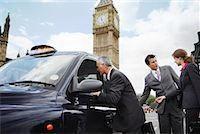 Businesspeople Getting in Taxi, London, England    Stock Photo - Premium Rights-Managednull, Code: 700-01248667
