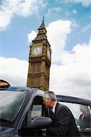 Businesspeople Getting in Taxi, London, England    Stock Photo - Premium Rights-Managednull, Code: 700-01248671