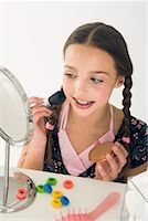 preteen  smile  one  alone - Girl Applying Make-Up    Stock Photo - Premium Rights-Managednull, Code: 700-01248711