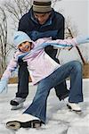 Father Catching Daughter while Skating    Stock Photo - Premium Royalty-Free, Artist: Masterfile, Code: 600-01249397
