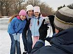 Father Taking Picture of Family Skating    Stock Photo - Premium Royalty-Free, Artist: Masterfile, Code: 600-01249400