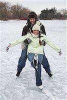 Man Catching Woman while Skating    Stock Photo - Premium Royalty-Freenull, Code: 600-01249411
