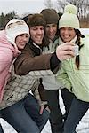 Friends Taking Pictures    Stock Photo - Premium Royalty-Free, Artist: Masterfile, Code: 600-01249429