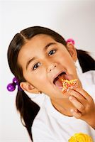 Portrait of a girl licking a candy Stock Photo - Premium Royalty-Freenull, Code: 625-01251966