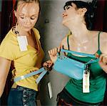 Women Trying on Clothing    Stock Photo - Premium Rights-Managed, Artist: Anne Wirtz, Code: 700-01259920