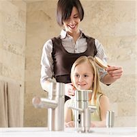 Mother Brushing Daughter's Hair    Stock Photo - Premium Royalty-Freenull, Code: 600-01260384