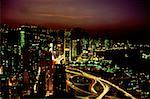 High angle view of buildings lit up at night, Causeway Bay, Hong Kong, China Stock Photo - Premium Royalty-Free, Artist: Glowimages               , Code: 625-01261226