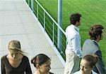 People standing and walking on walkway Stock Photo - Premium Royalty-Free, Artist: iRepublic, Code: 632-01271209