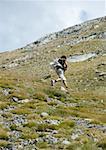 Hiker running uphill