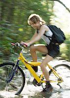 Mountain biker riding through water, motion Stock Photo - Premium Royalty-Freenull, Code: 633-01274411