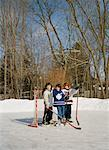 Friends on Backyard Hockey Rink    Stock Photo - Premium Royalty-Free, Artist: Wayne Eardley, Code: 600-01275357