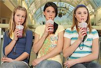 Three Teenagers with Drinks    Stock Photo - Premium Royalty-Freenull, Code: 600-01275537