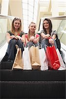 Teenagers Sitting on Escalator    Stock Photo - Premium Royalty-Freenull, Code: 600-01275604