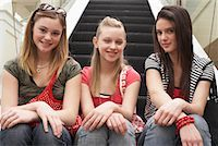 Teenagers Sitting on Escalator    Stock Photo - Premium Royalty-Freenull, Code: 600-01275605