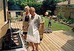 Couple Barbequing with Granddaughter in Backyard    Stock Photo - Premium Rights-Managed, Artist: Masterfile, Code: 700-01275712