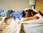 Girl Lying on Bed    Stock Photo - Premium Rights-Managed, Artist: Kristin Sjaarda, Code: 700-01276090