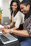 Couple Using Laptop Computer    Stock Photo - Premium Royalty-Free, Artist: Masterfile, Code: 600-01276349