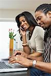 Couple with Laptop Computer and Cellular Phone    Stock Photo - Premium Royalty-Free, Artist: Masterfile, Code: 600-01276350