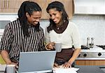 Couple with Bills and Laptop Computer    Stock Photo - Premium Royalty-Free, Artist: Masterfile, Code: 600-01276353