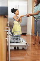 picture black girl washing dishes - Sisters Unloading Dishwasher    Stock Photo - Premium Royalty-Freenull, Code: 600-01276404