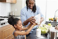 Father and Daughter Making Applesauce in Kitchen    Stock Photo - Premium Royalty-Freenull, Code: 600-01276409
