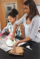 picture black girl washing dishes - Sisters Washing Dishes    Stock Photo - Premium Royalty-Freenull, Code: 600-01276418