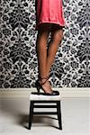 Woman wearing high heels shoes, standing on stool, low section Stock Photo - Premium Royalty-Free, Artist: ableimages, Code: 613-01285633