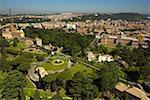Italy, Rome, Urban landscape taken from St Peter's basilica with trees in foreground, elevated view Stock Photo - Premium Royalty-Freenull, Code: 613-01289238