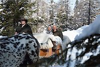 Couple on Sleigh Ride    Stock Photo - Premium Rights-Managednull, Code: 700-01296143