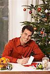 Man Writing Christmas Cards    Stock Photo - Premium Rights-Managed, Artist: Masterfile, Code: 700-01296246