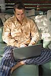 Mid-adult man using laptop computer outdoors Stock Photo - Premium Royalty-Free, Artist: Robert Harding Images    , Code: 621-01305537