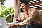 Mid-adult man using laptop computer outdoors Stock Photo - Premium Royalty-Free, Artist: Robert Harding Images, Code: 621-01305631