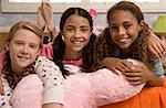 Three smiling preteen girls