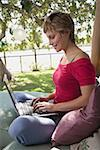 Mid-adult woman using laptop computer outdoors Stock Photo - Premium Royalty-Free, Artist: Sheltered Images, Code: 621-01305776