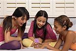 Preteen girls writing a note
