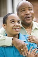 Close-up of a father embracing his son Stock Photo - Premium Royalty-Freenull, Code: 638-01330965