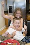 Brother and sister playing in kitchen Stock Photo - Premium Royalty-Free, Artist: KL Services, Code: 638-01331826